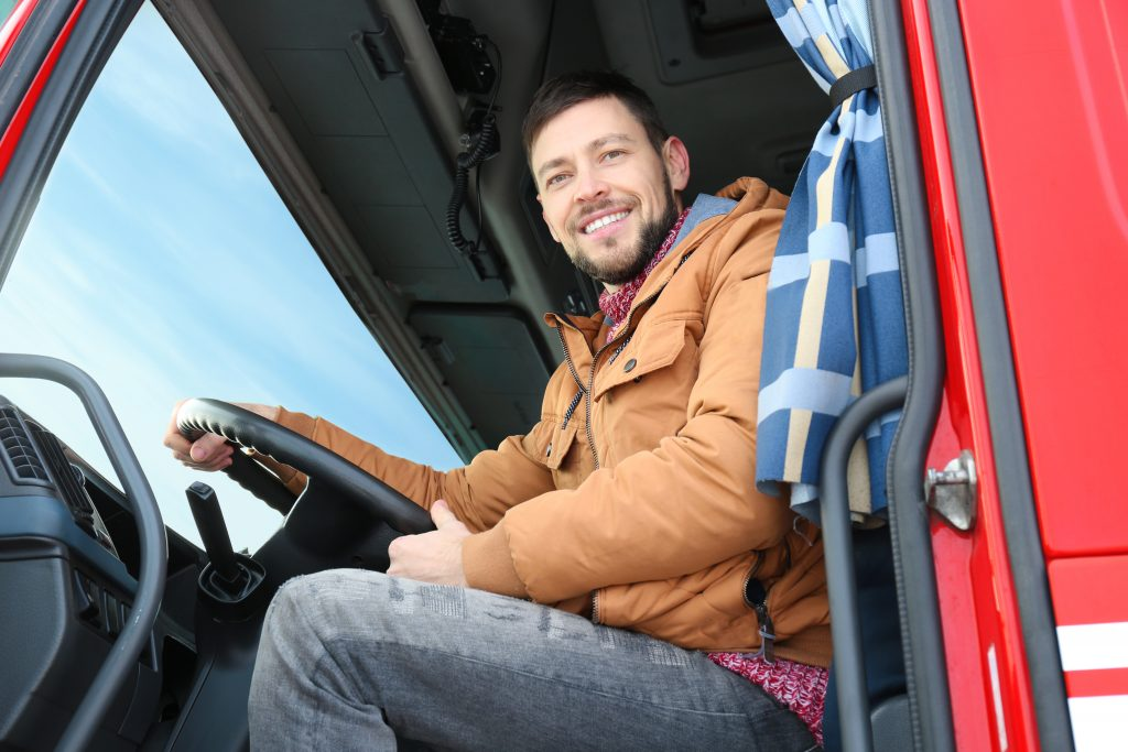 truck driver smiling in truck